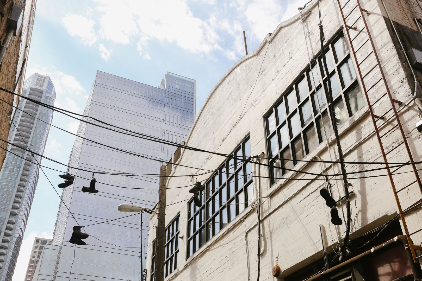 A photo depicting Austin Texas Shoes On Power Line Wide Shot
