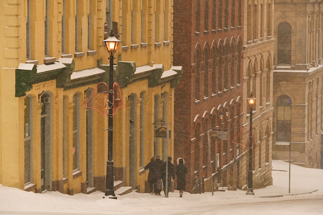 Click thumbnail to see details about photo - Walking Down Princess Street In Snow