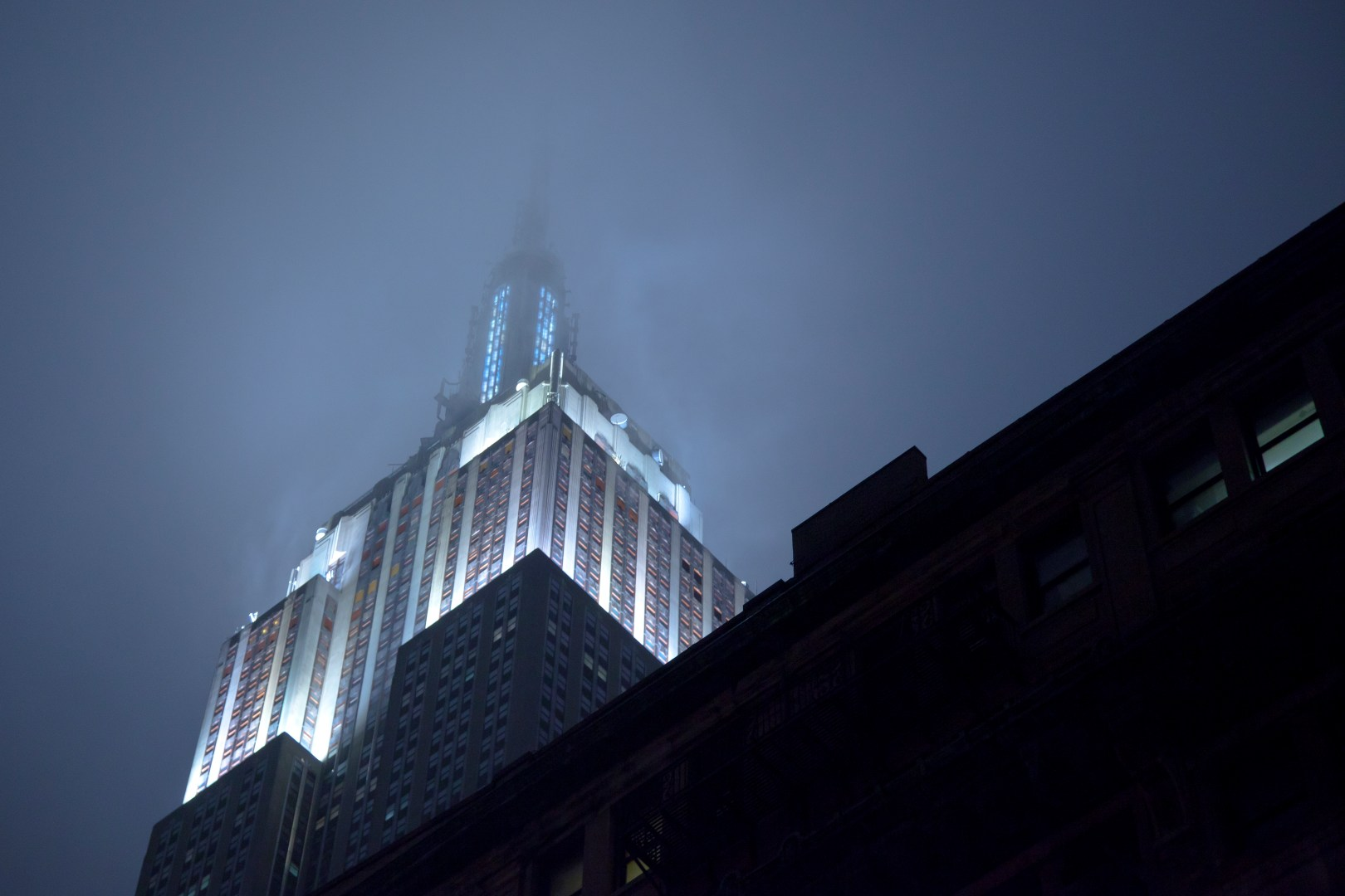 A photo of New York City Empire State Building At Night With Fog