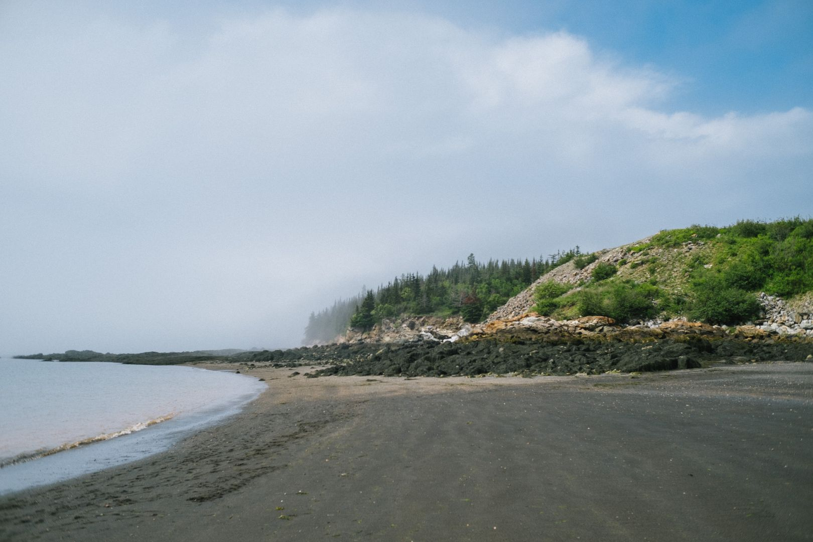 A photo depicting Black Beach in Saint John