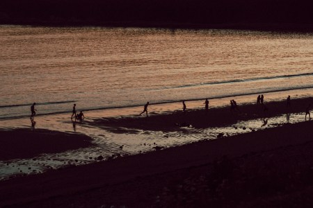 A photo of Mispec Beach Kids Playing at Dusk