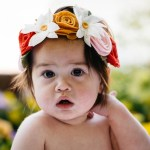toddler with flower headband