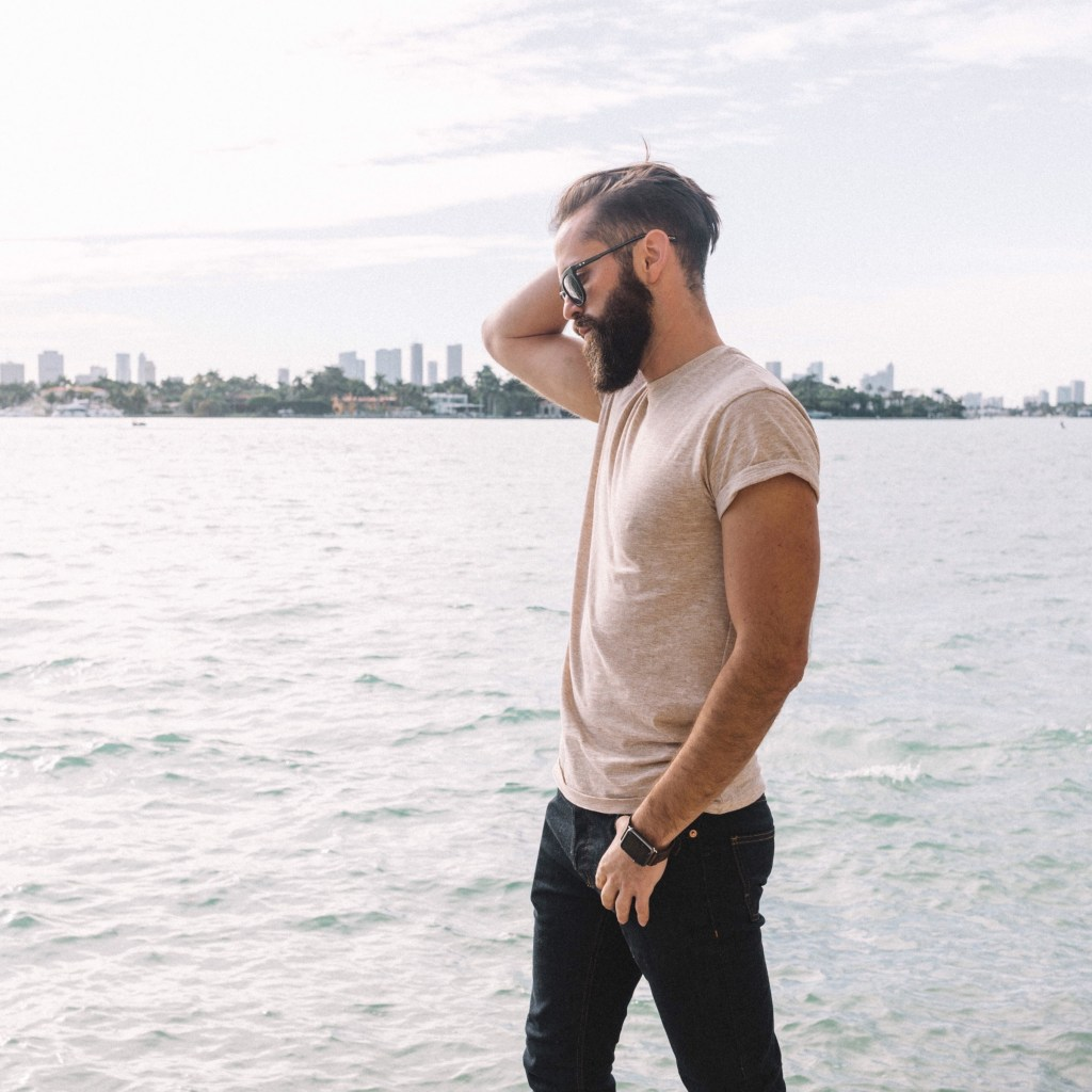 Michael Checkers men's street style blogger modeling Topman jeans and t-shirt in Miami Beach