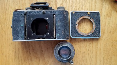 Removing the lens, shutter, and front plate is a matter of removing 7 screws.