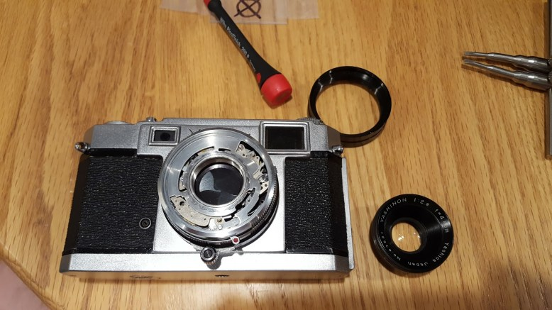 With the front lens grouping removed, you have access to the shutter. I chose not to remove the shutter from the camera, and performed several cycles of cleaning with naphtha oil until the shutter worked properly.