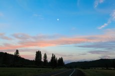 The sun's final rays light up the clouds with the moon brightly shining down on me. --New Meadows, ID