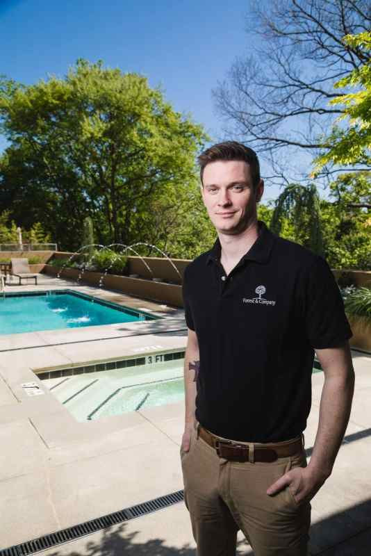 Atlanta real estate brand portraits of realtor next to pool