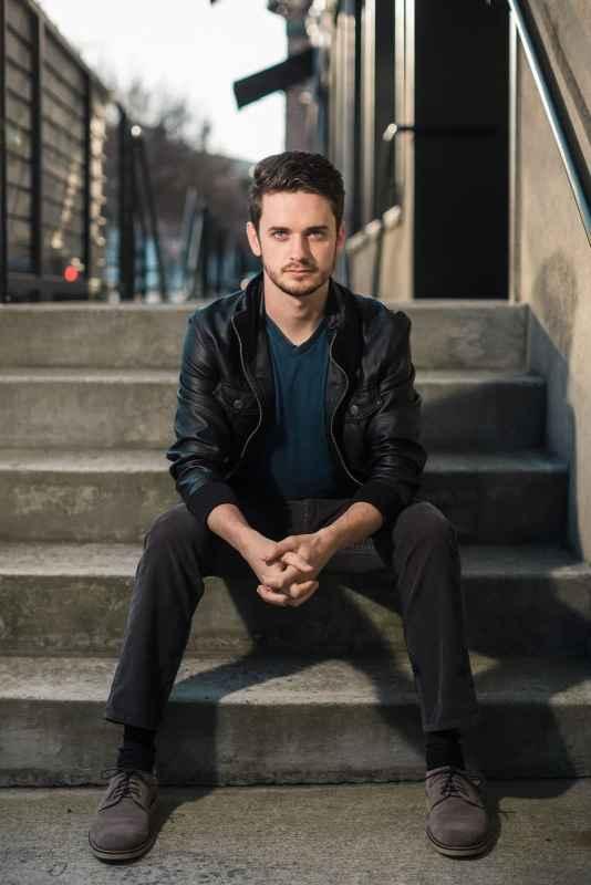 male model portrait sitting on steps of west midtown atlanta