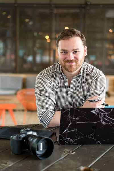 portrait of atlanta photographer Mike Glatzer working on laptop in dancing goats coffeeshop atlanta