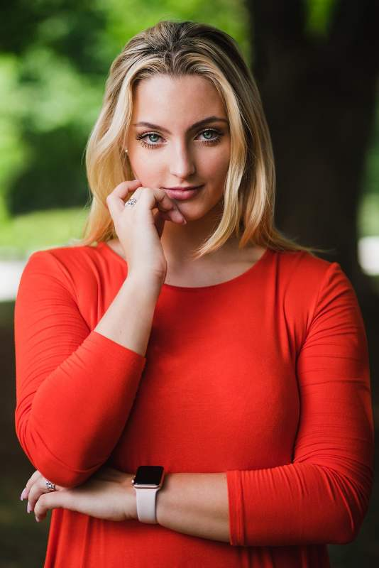 high school senior flash portrait in red dress with arms crossed