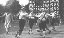 The Manchester Morris Men outside Little Moreton Hall on 8 May 1954.