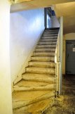 The 18th century stairs down to the Tudor basement.