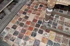 Re-used medieval tiles pave the floor of the chancel.