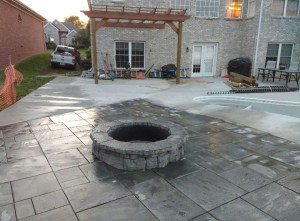 Paver Patio with Built in Fire Pit next to existing concrete