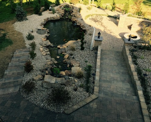 Paver Patio and Paver Walkway with built in Fire pit and Water Feature