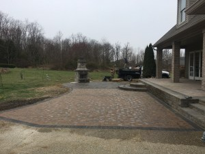 Custom Paver Patio with Retaining Wall Deck and Fire Pit