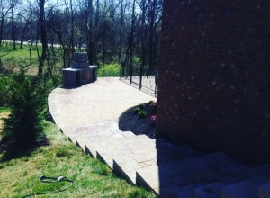 Paver walkway staircase that leads to a Paver Patio with Fire Pit