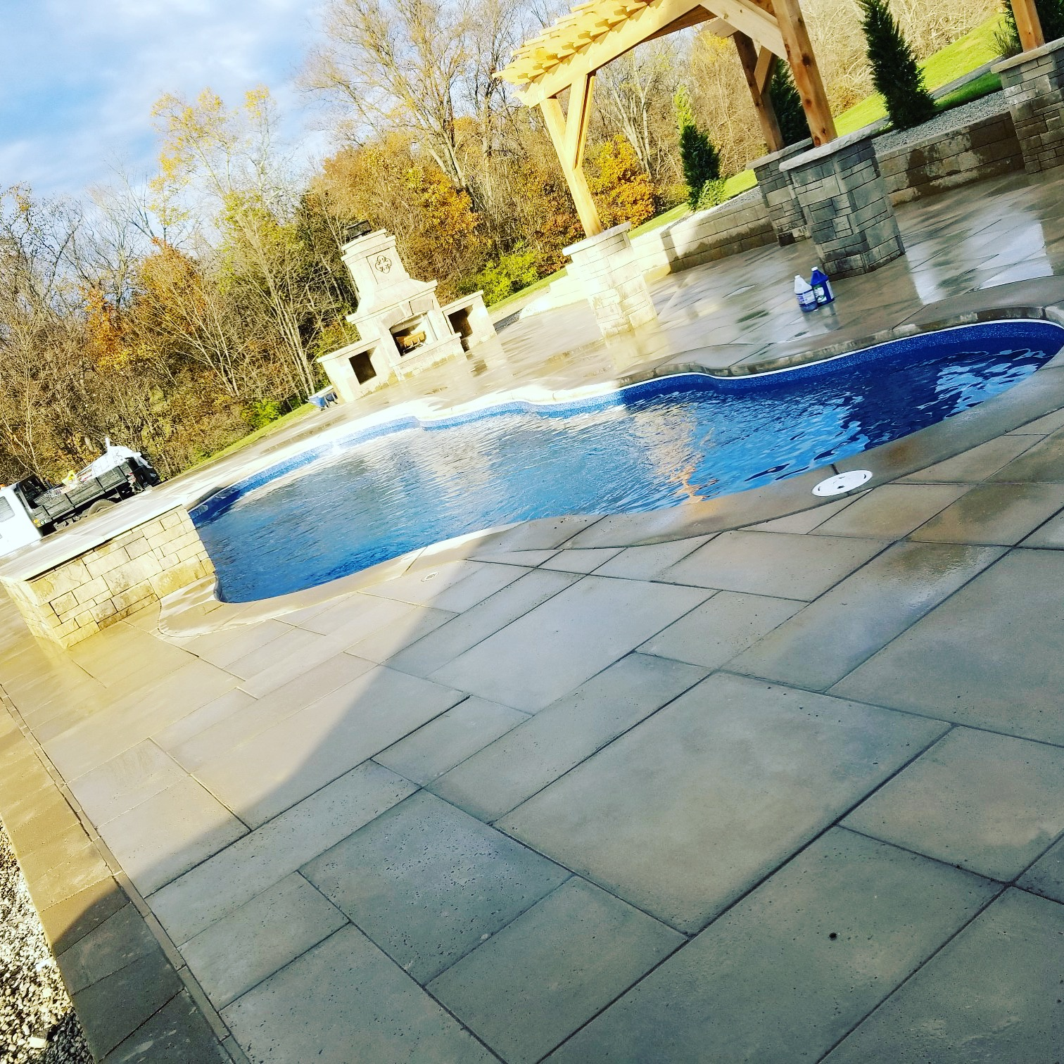 In-ground pool with Fire Pit and Pavilion. Paver patio Deck.