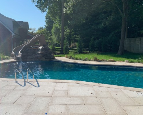 louisville inground pool with water slide and paver deck
