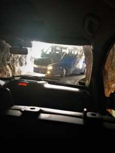 a picture from the front seat of our car as our driver barely avoids al large tour bus entering the same tunnel we were trying to exit.