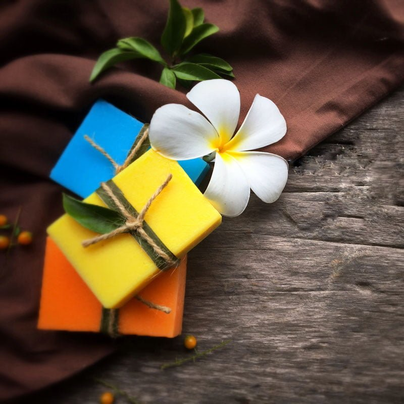 natural oil soap with plumeria flower on wooden background t20 mR8o4m