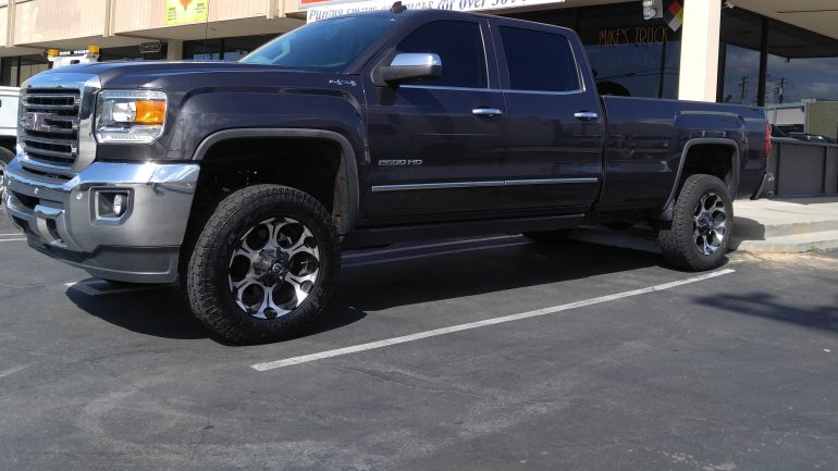 "2015 GMC 2500 Installed 4"" lift -  Fabtech Dirt Logic 20X9 Fuel Dune Rims w 275/65R20 Toyo Open Country(34"" tall)"