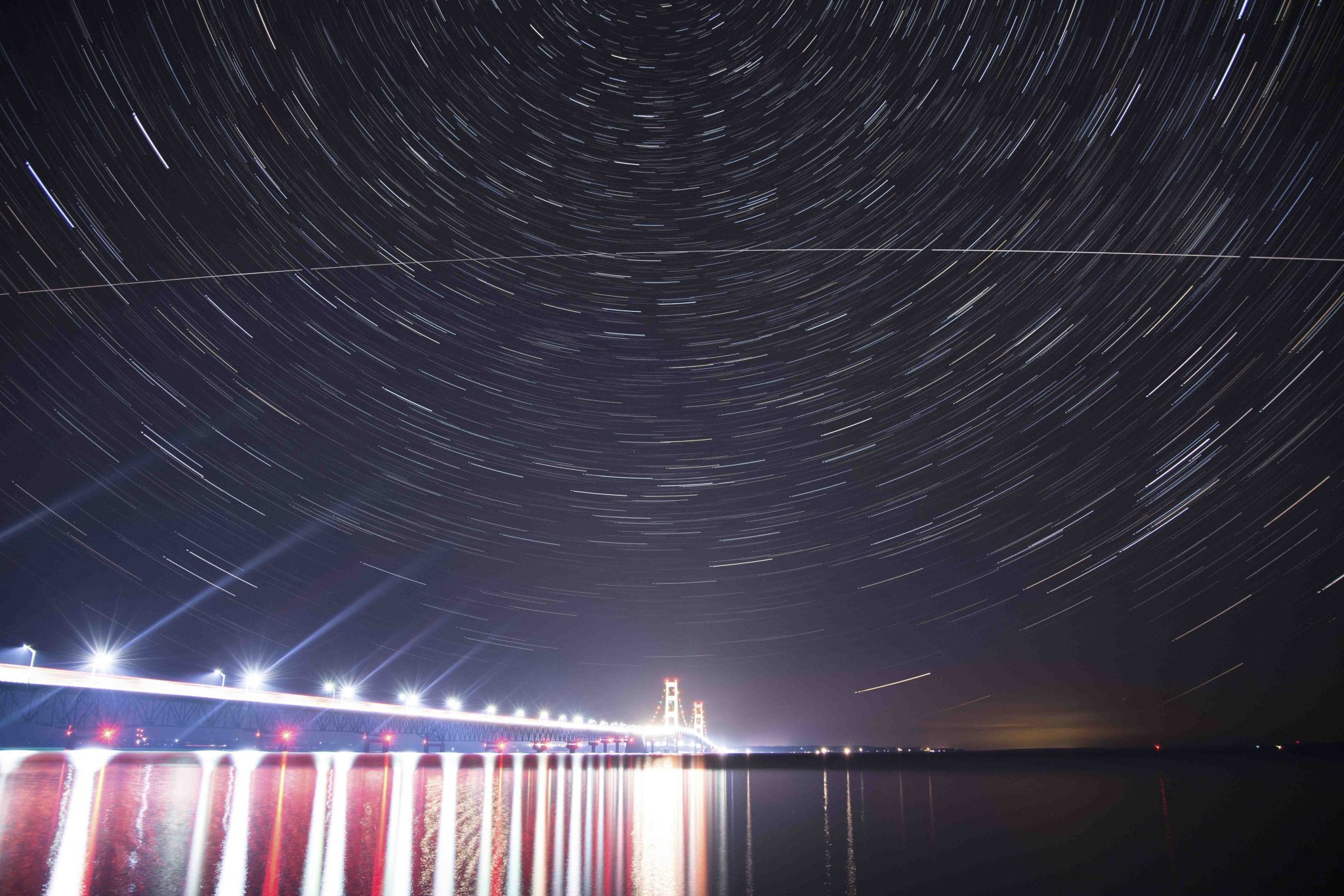 Star trails over the Mackinac Bridge