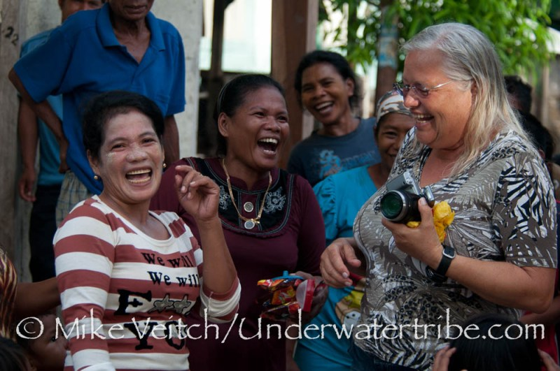 Tourist Laughing with Locals