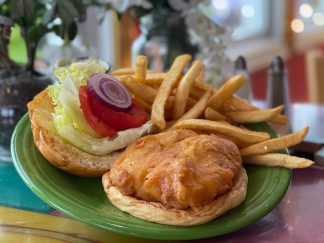 Crispy, English-style fresh haddock on a sweet roll with lettuce, tomato and red onion; tartar sauce on the side