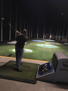 Look at that technique. Tiger Woods would be proud.