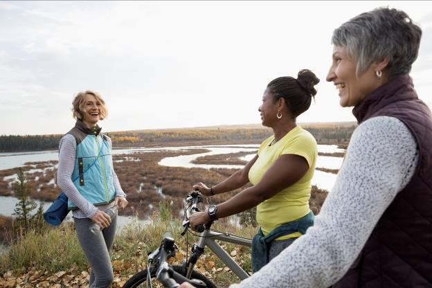 Elderly people being active, biking around nature