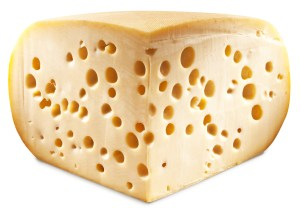 Quarter of Emmental cheese head isolated on a white background.