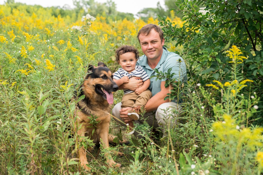 Family session for a dad and a toddler son and a dog at SongBird Slough Forest Preserve in Itasca by family photographer Mila Craila Photography