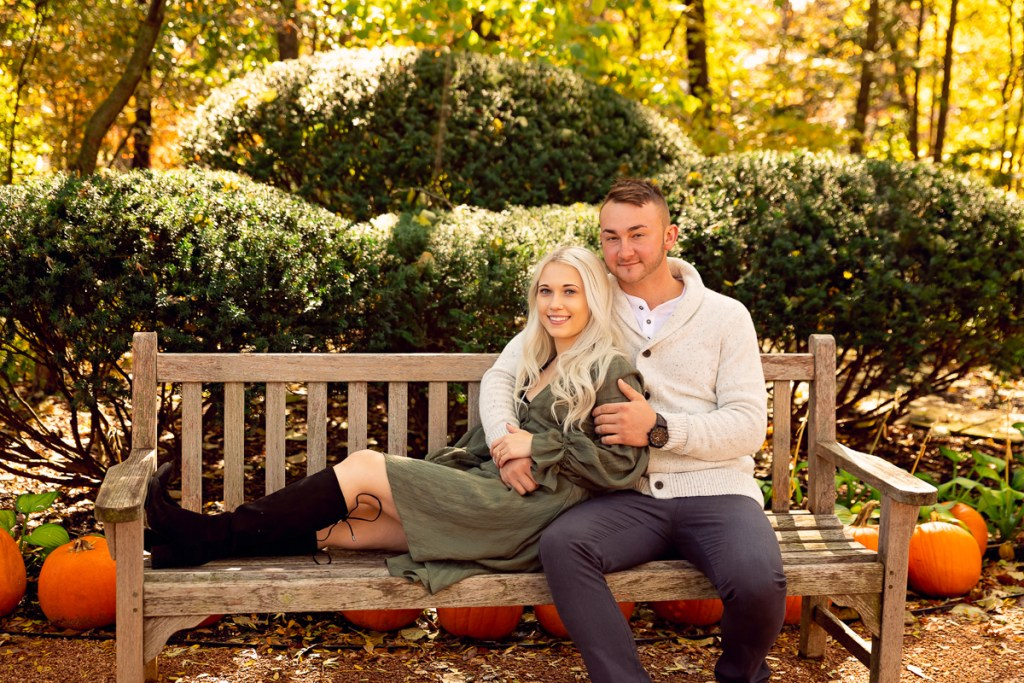 An engagement session for an engaged couple on the bench at Cantigny Park in Wheaton in the fall by a wedding photographer Mila Craila Photography
