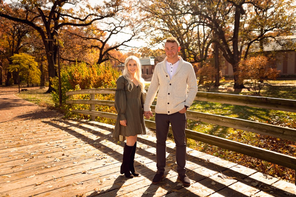 An engagement session for an engaged couple on the bridge at Cantigny Park in Wheaton in the fall by a wedding photographer Mila Craila Photography
