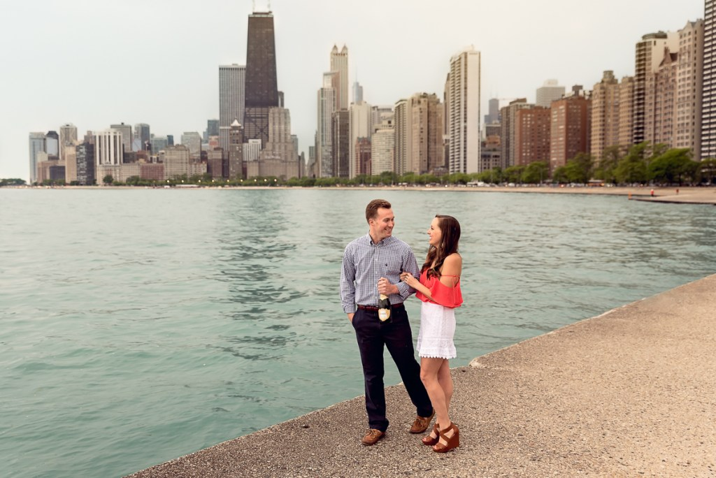 An engagement session for an engaged couple on North Avenue Beach in Chicago in the spring by a wedding photographer Mila Craila Photography