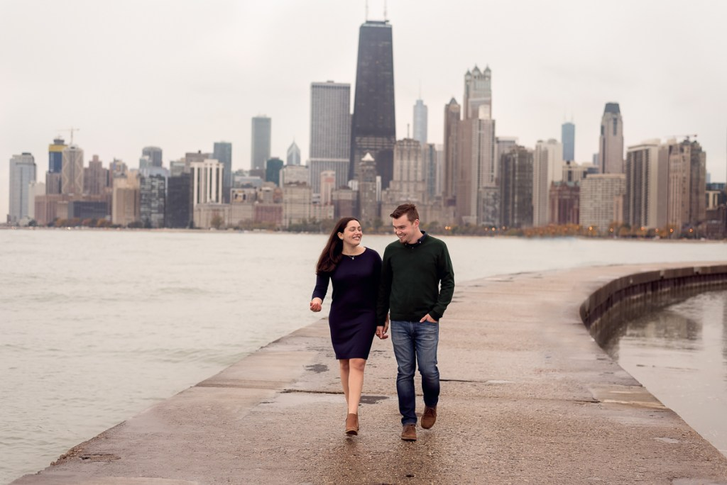 An engagement session for an engaged couple on North Avenue Beach in Chicago in the fall by a wedding photographer Mila Craila Photography