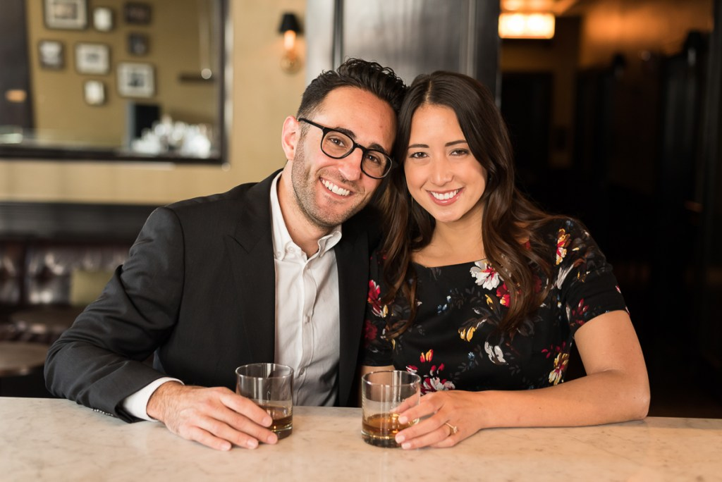 An engagement session for an engaged couple at a bar in downtown Chicago in the fall by a wedding photographer Mila Craila Photography