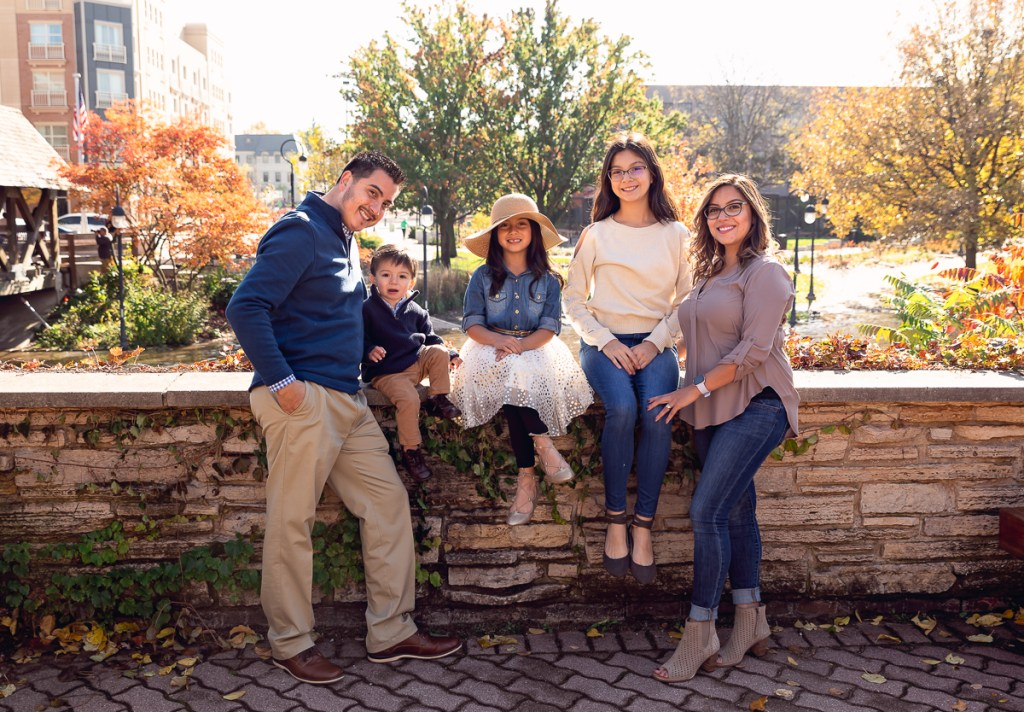 Family session for a family with three kids near the bridge on Naperville Riverwalk by family photographer Mila Craila Photography