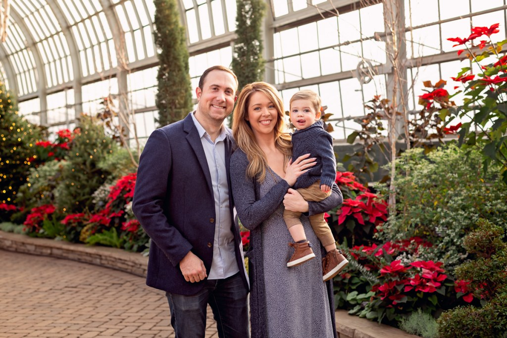 Family session for parents and a toddler son at Garfield Park Conservatory in Chicago on Christmas by family photographer Mila Craila Photography