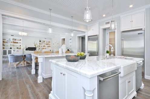 Modern and classic white kitchen theme a bianco carrara marble counter top with a nice edge profiling