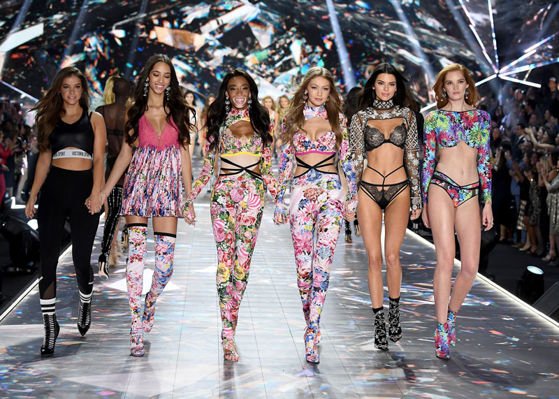 NEW YORK, NY - NOVEMBER 08:  (L-R) Barbara Palvin, Yasmin Wijnaldum, Winnie Harlow, Gigi Hadid, Kendall Jenner, and Alexina Graham walk the runway during the 2018 Victoria's Secret Fashion Show at Pier 94 on November 8, 2018 in New York City.  (Photo by Dimitrios Kambouris/Getty Images for Victoria's Secret)