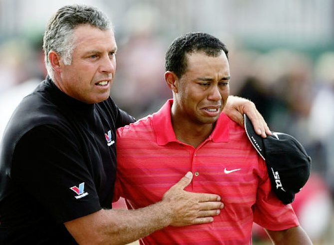 HOYLAKE, UNITED KINGDOM - JULY 23: Tiger Woods of USA walks off the 18th green in tears with his caddy Steve Williams following his victory at the end of the final round of The Open Championship at Royal Liverpool Golf Club on July 23, 2006 in Hoylake, England. (Photo by Andy Lyons/Getty Images) *** Local Caption *** Tiger Woods;Steve Williams Original Filename: 56470743RM197_135th_Open_Ch.jpg