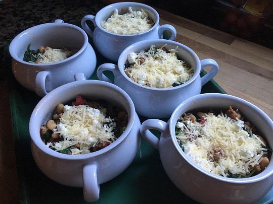 sausage, bean, and spinach gratin in ramekins