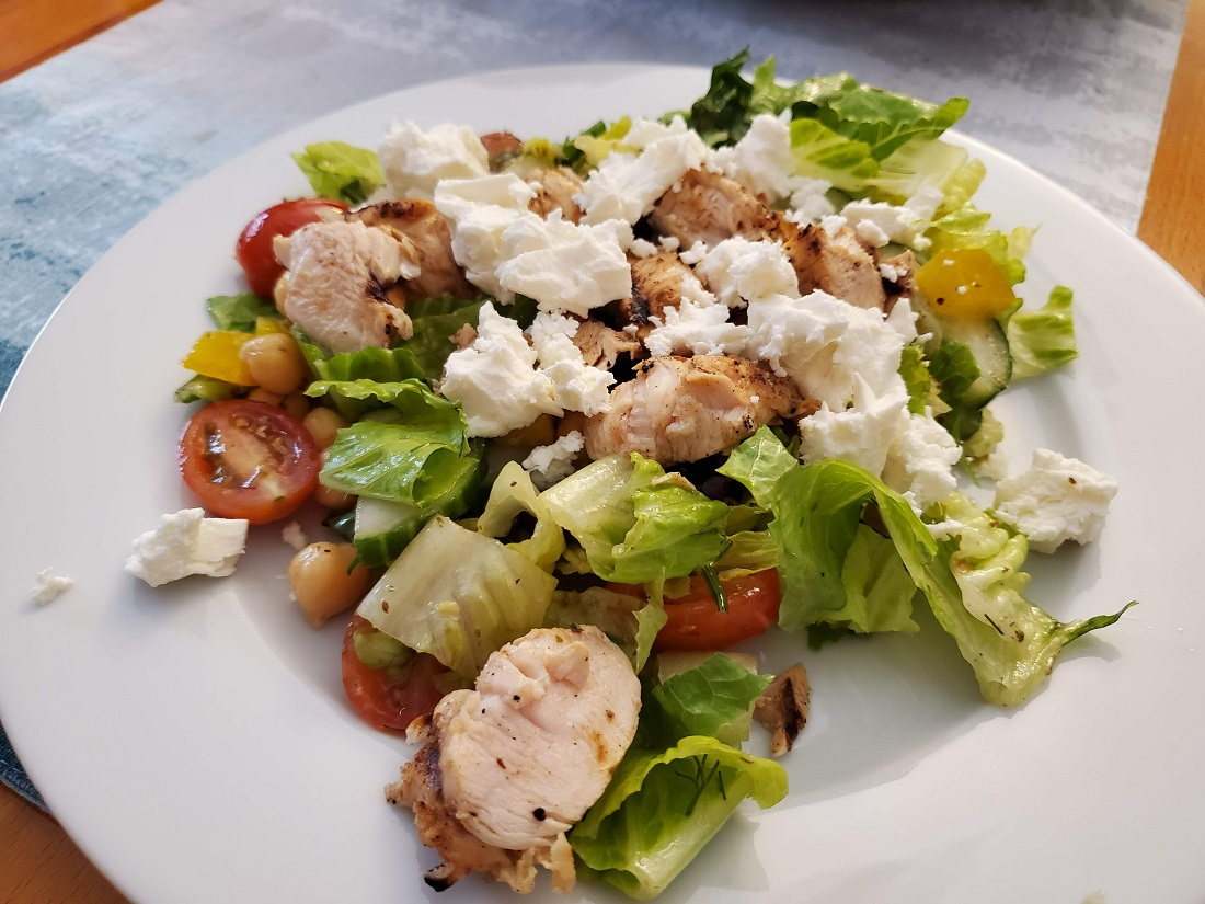 big vegetable salad with grilled chicken