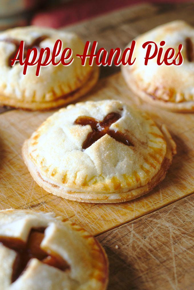 Apple Hand Pies – A personal apple pie great for serving at fall parties or baking with kids! Pie crusts filled with the BEST homemade apple pie filling! Apple pie | apple hand pies | hand pie recipe #apple #applerecipe #fall #fallbaking #baking #dessert #recipe #easyrecipe #dessertrecipe #pie