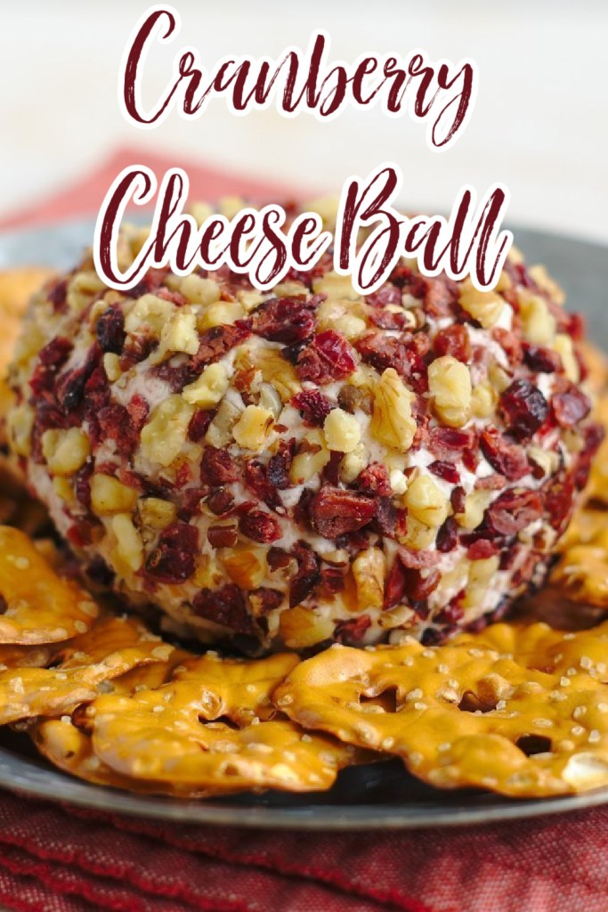 Cranberry Goat Cheese Ball - A quick and easy appetizer perfect for the holidays! Cranberry cinnamon goat cheese and cream cheese topped with dried cranberries and nuts! Cheese Ball Recipe | Cranberry Cheese Ball Recipe | Holiday Cheese Ball