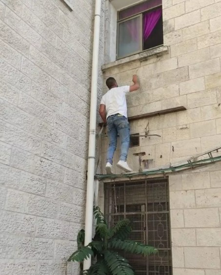 Man cllimbing window