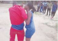 PEOPLE SAY CHRISTMAS IS A SEASON OF LOVE...BUT NOT FOR THIS MAN THRASHING HIS BABY MAMA...SEE PICS