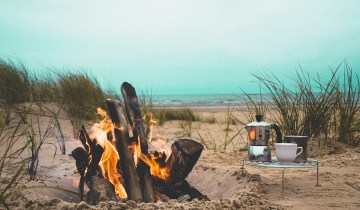 Campfire and coffee on a beach